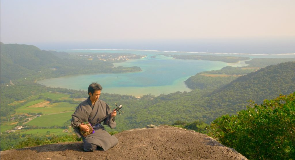 Kabira bay musician sanshin hikinh in ishigaki island japan
